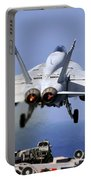 An Fa-18e Super Hornet Takes Portable Battery Charger