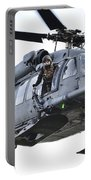 An Hh-60g Pavehawk Helicopter In Flight Portable Battery Charger