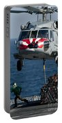 An Mh-60s Sea Hawk Picks Up Pallets Portable Battery Charger