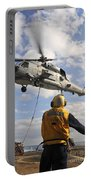 An Sh-60b Sea Hawk Helicopter Releases Portable Battery Charger