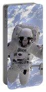 Astronaut Gernhardt On Robot Arm Portable Battery Charger