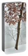 Autumn Leaves In Winter Snow Storm Portable Battery Charger
