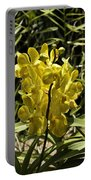 Beautiful Yellow Flowers Inside The National Orchid Garden In Si Portable Battery Charger