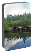 Big Sky And Docks On The River Portable Battery Charger