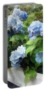 Blue Hydrangea On White Fence Portable Battery Charger