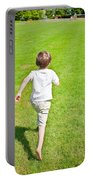 Boy Running Portable Battery Charger