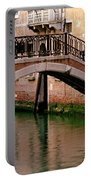Bridge And Striped Poles Over A Canal In Venice Portable Battery Charger
