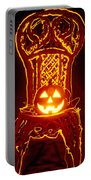 Carved Smiling Pumpkin On Chair Portable Battery Charger
