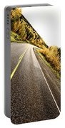 Center Lines Along A Paved Road In Autumn Portable Battery Charger
