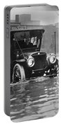 Cleveland: Flood, C1913 Portable Battery Charger