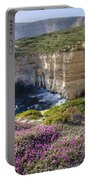 Cliffs Along Ocean With Wildflowers Portable Battery Charger
