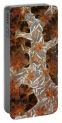 Close-up Of Soft Coral Revealing Portable Battery Charger by Terry Moore