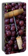 Corkscrew And Wine Cork On Red Grapes Portable Battery Charger