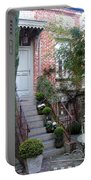 Courtyard In Honfleur Portable Battery Charger by Carla Parris