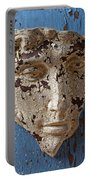 Cracked Face On Blue Wall Portable Battery Charger
