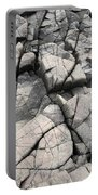 Cracked Rocks On Shore Portable Battery Charger