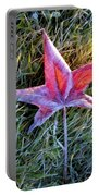 Fallen Autumn Leaf In The Grass During Morning Frost Portable Battery Charger