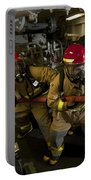 Firemen Combat A Simulated Fire Aboard Portable Battery Charger