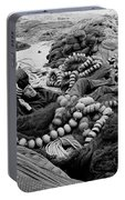 Fisherman Sleeping On A Huge Array Of Nets Portable Battery Charger