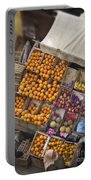 Fruit Vendor In The Kahn Portable Battery Charger by Mary Machare