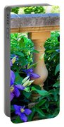 Garden Wall With Periwinkle Flowers Portable Battery Charger