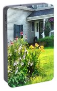 Garden With Coneflowers And Lilies Portable Battery Charger