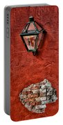 Gaslight On A Red Wall Portable Battery Charger