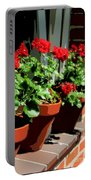 Geraniums In Germany Portable Battery Charger by Carol Groenen