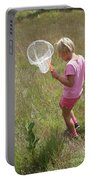 Girl Collecting Insects In A Meadow Portable Battery Charger