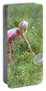 Girl Collects Insects In A Meadow Portable Battery Charger by Ted Kinsman