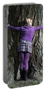 Girl Hugging Tree Trunk Portable Battery Charger by Joana Kruse