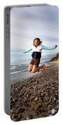 Girl Jumping At Lake Superior Shore Portable Battery Charger