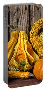 Gourds Against Wooden Wall Portable Battery Charger