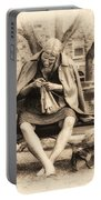 Granny Sitting On A Bench Knitting Ursinus College Portable Battery Charger