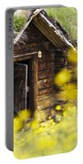 House Behind Yellow Flowers Portable Battery Charger