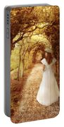 Lady Walking In Tree Tunnel In Garden Portable Battery Charger