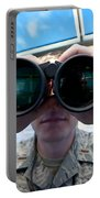 Lieutenant Uses Binoculars To Scan Portable Battery Charger by Stocktrek Images