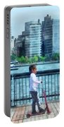 Little Girl On Scooter By Manhattan Skyline Portable Battery Charger