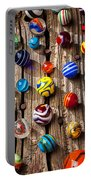 Marbles On Wooden Board Portable Battery Charger