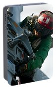 Mechanic Inspects An Mh-60r Sea Hawk Portable Battery Charger