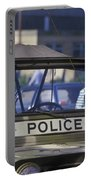 Military Policeman Stands Next Portable Battery Charger by Michael Wood