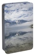 mist burning off Lake Bohinj Portable Battery Charger