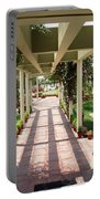 Mix Of Light And Shade Under A Partially Covered Pathway With Pillars Portable Battery Charger