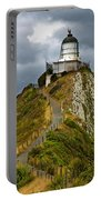 Nugget Point Light House And Dark Clouds In The Sky Portable Battery Charger
