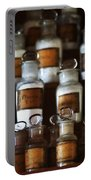 old pharmacy 2 - Old glass bottle with medicine powder of xviii century Portable Battery Charger