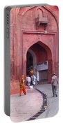 People Entering The Entrance Gate To The Red Colored Red Fort In New Delhi In India Portable Battery Charger