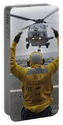 Petty Officer Guides An Sh-60r Sea Hawk Portable Battery Charger