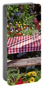 Picnic Table Among The Flowers Portable Battery Charger