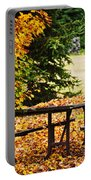 Picnic Table With Autumn Leaves Portable Battery Charger