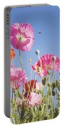 Pink Flowers Against Blue Sky Portable Battery Charger